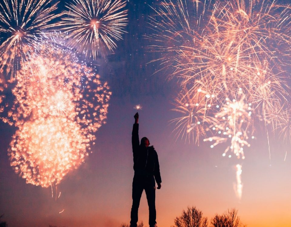 a boy standing under fireworks to Celebrate new year